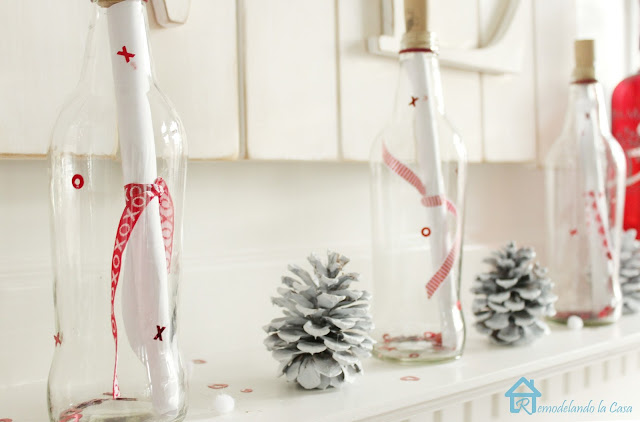 Clear glass bottles with paper messages for Valentines
