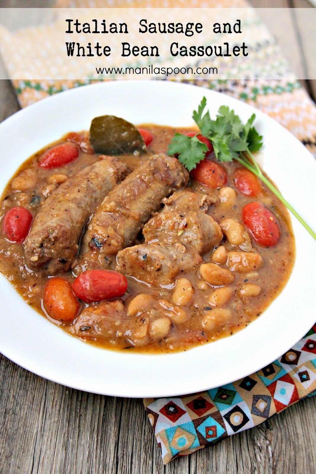 Loads of Italian sausages, tomatoes, herbs and white beans give full flavor to this hearty and delicious stew - Italian Sausage and White Bean Cassoulet! Fall and winter-perfect stew.