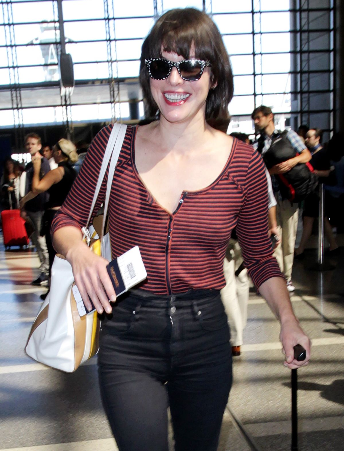 Milla Jovovich at Los Angeles International Airport