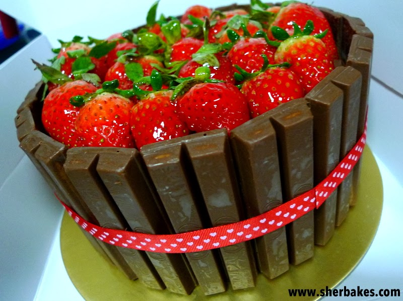 Chocolate Kit Kat Cake with a bed of Strawberries - Sherbakes