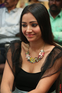 Swetha Basu in a Black Sleeveless Top Long Skirt at Mixture Potlam Movie Audio Launch 033.JPG