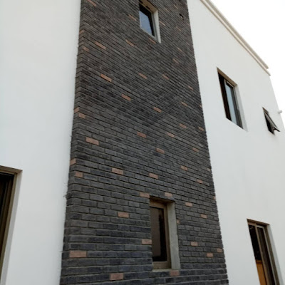 Antique bricks in black and beige colors