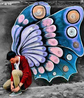 Salah satu mural berbentuk sayap kupu-kupu di Kampung Tridi. Foto oleh @ahmadnrslm