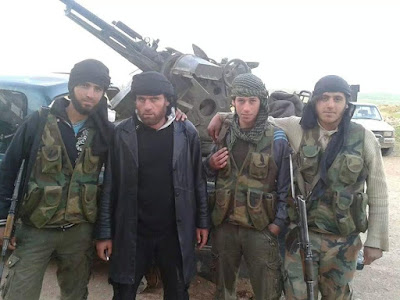 98cd5e395c424 Fouad al-Ghraibi is seen (2ndL) with fighters in this undated photo in  Idlib