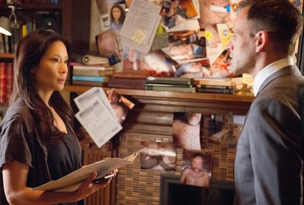Jonny Lee Miller Lucy Liu as Sherlock Holmes Joan Watson in CBS Elementary Season 3 Episode 2 The Five Orange Pipz