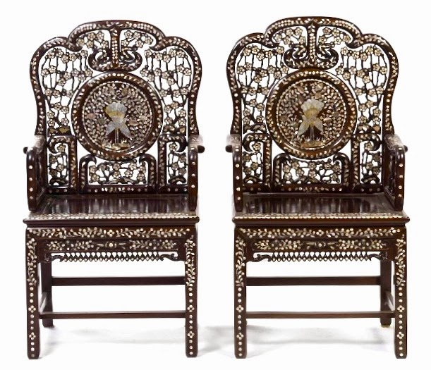 A Majestic Pair Of Carved Rosewood Chairs With Myriad Mother Pearl Inlay Featuring Peas Decorating The Center Panels Sort Asian Take On Art