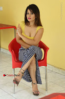 Cute Telugu Actress Shunaya Solanki High Definition Spicy Pos in Yellow Top and Skirt  0443.JPG