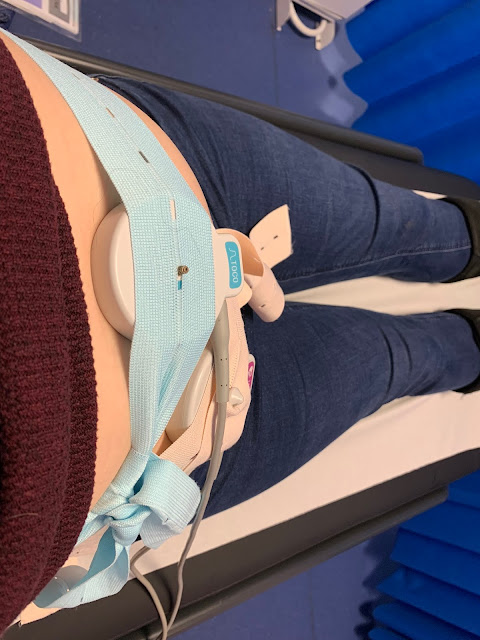 Transducers on a pregnant tummy held on my elastic straps