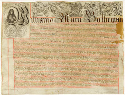 "A manuscript with a very ornate header beginning ""William and Mary"""