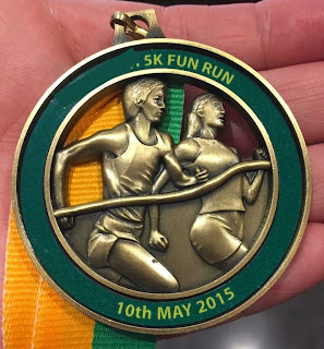 Morgan's Milieu | Health & Weight Loss Tips 18: A bronze medal with running people on it.
