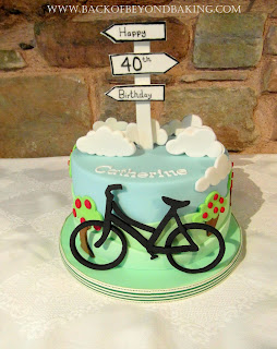40th birthday cake signpost and bike