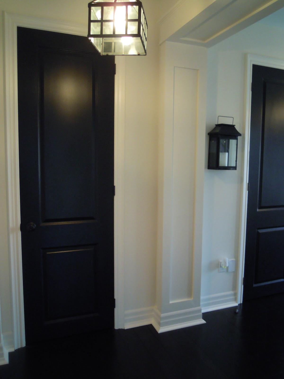 White Wood Black Doors Add Drama
