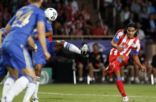 Atlético Madrid striker Radamel Falcao curls a shot to score a goal against Chelsea