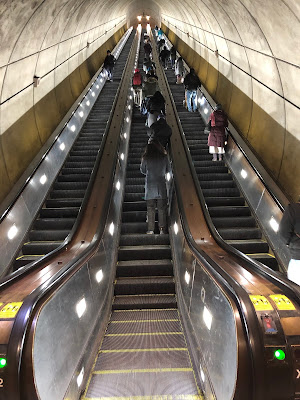 Photo of three veeeeery long escalators