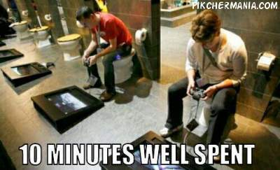 men sitting on toilet bowl and playing games