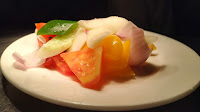Cut tomato cucumber onion Bell pepper in plate for Greek salad Recipe