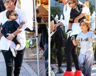 c3d55de5973b4 Kris Jenner Wearing Nike Air Yeezy 2 Red Octobers With Baby North West    Mason Disick