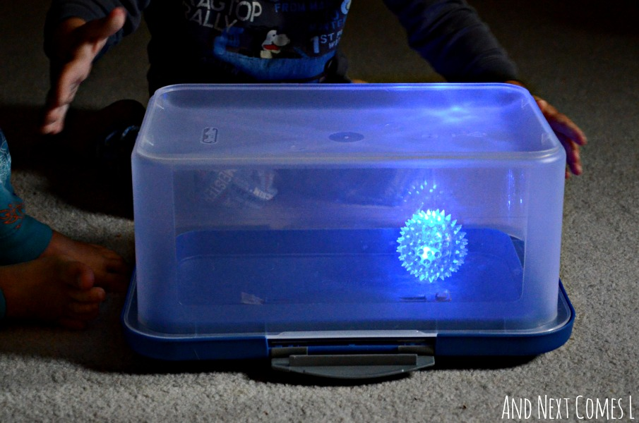 Gross motor boredom buster idea for toddlers using a glow ball - teaches kids about cause and effect from And Next Comes L