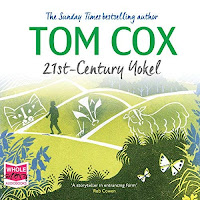 21st-Century Yokel audiobook cover. A man walks along a path on green hills, with the chalk outlines of a cat, badger, and sheep on each one (from left to right).