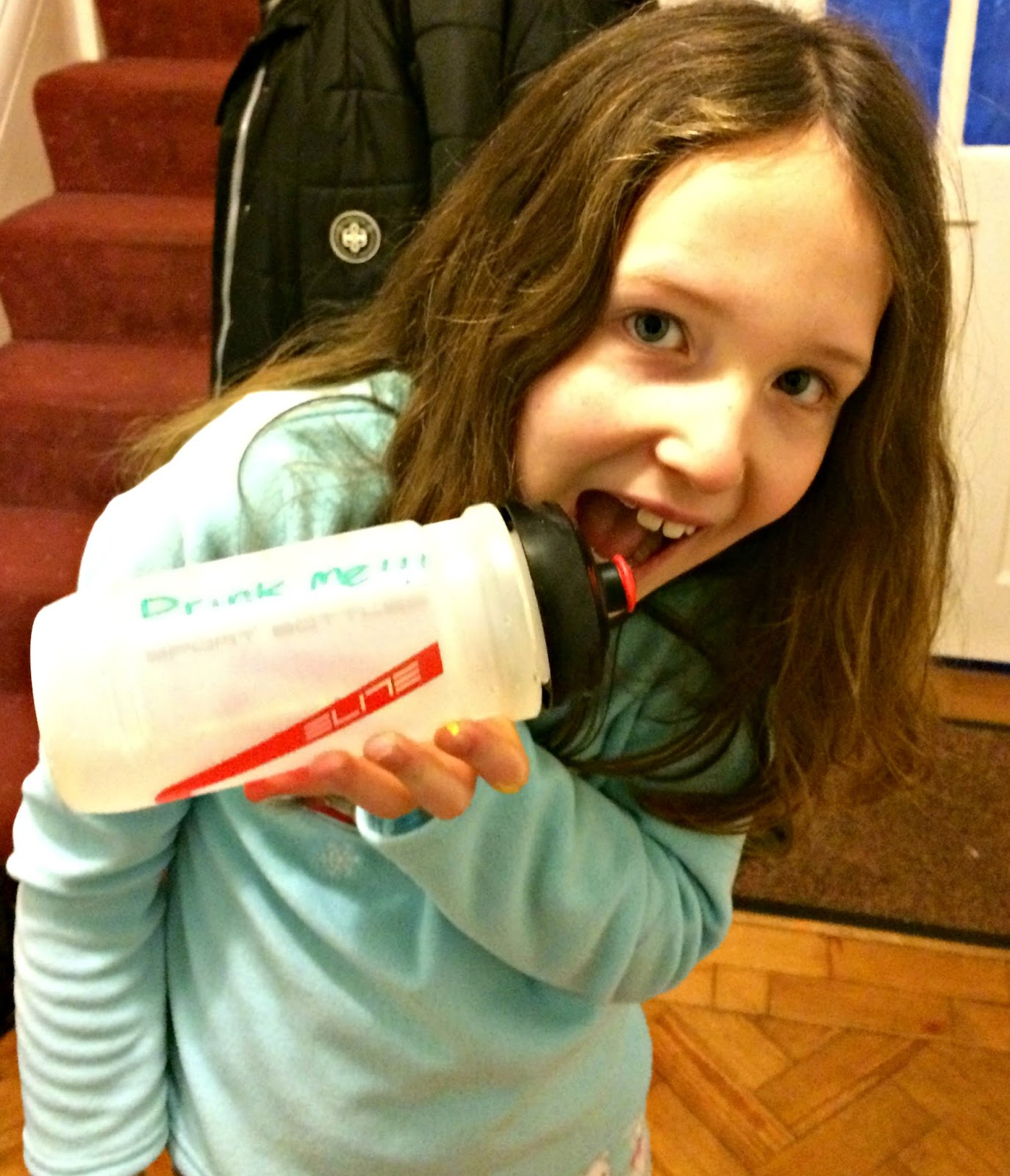 Caitlin with inscribed water bottle saying drink me