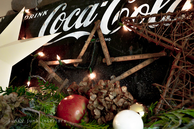 Coca Cola inspired Christmas fireplace mantel decorating with stars - via : https://www.funkyjunkinteriors.net/