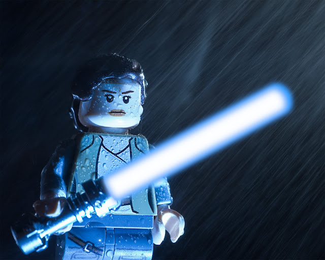Rey is ready for action, despite the harsh rain of Ahch-To Island