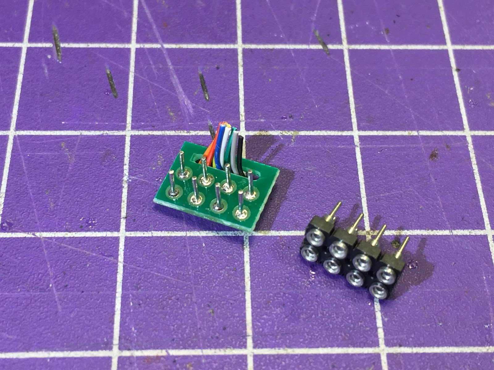 snipped loksound plug on the left, with tiny wire pigtails