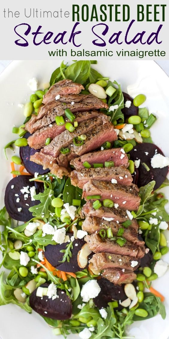 An epic 30 Minute Roasted Beet Steak Salad a new dinner favorite! This easy healthy salad is filled with fresh arugula, spinach, goat cheese, edamame, tender beets, topped with seared steak and drizzled with a balsamic vinaigrette. The perfect bite! #glutenfree