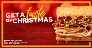 A red rectangle with get a taste of christmas in bold white font with a light golden brown sub filled with brown meat and green salad with a green subway logo on the bottom left on a white background