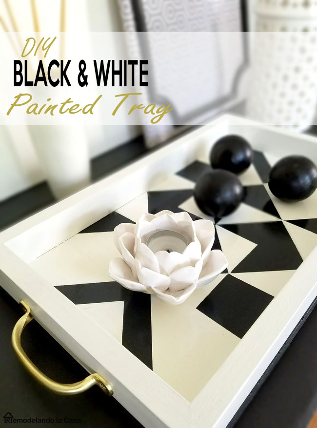 white lotus candleholder, black wooden balls, geometric designs on tray