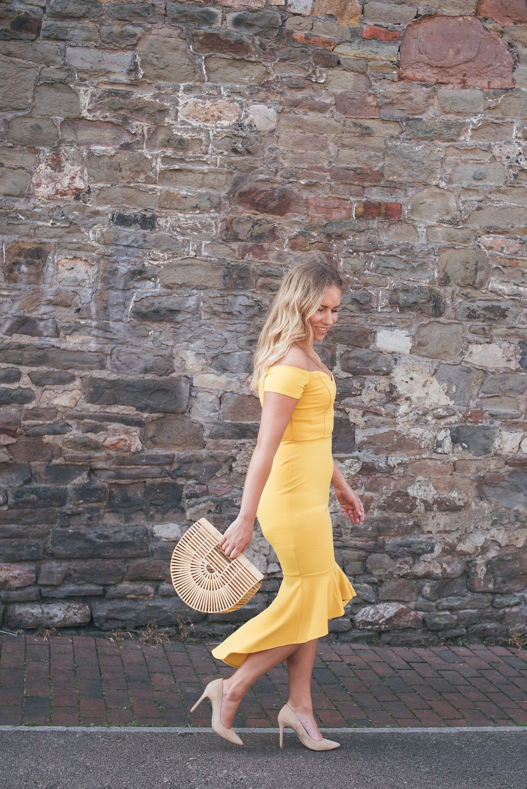 Rachel Emily Walking in Yellow John Zack Dress with Fishtail Movement and Bamboo Bag
