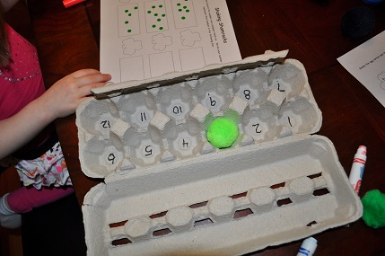 St. Patrick's day worksheet on number recognition using hands on activitiy
