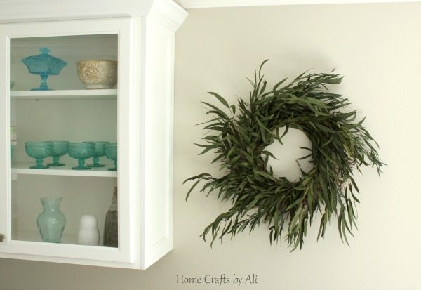 Eucalyptus wreath hanging on wall as home decor