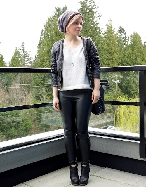 styling faux-leather leggings with a quilted pleather jacket, v-neck sweatshirt, wedge booties, and mohair beanie