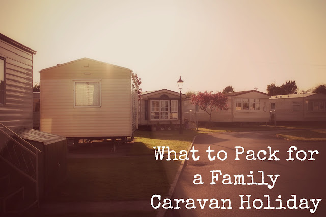 what to pack for a family caravan holiday blog post with caravan essentials - header image of caravan park at sunset / dawn