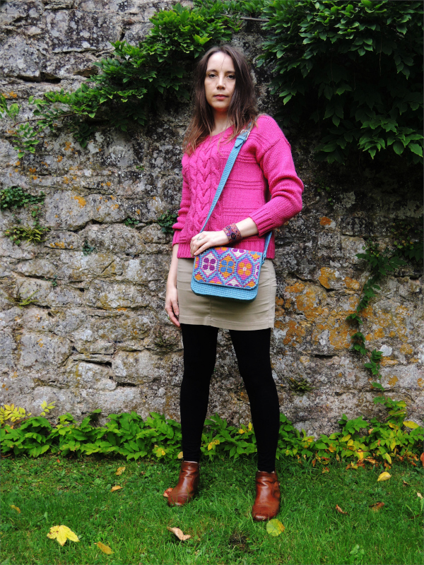 Model wearing preppy boho style teamed with repeat pattern needlepoint satchel by Bobbin and Fred