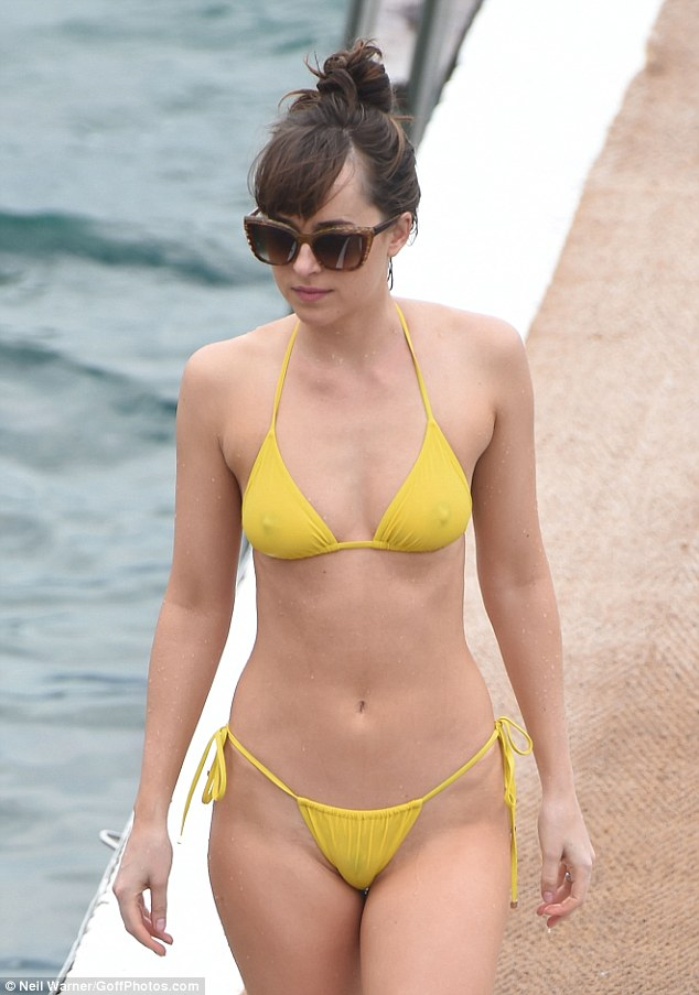 Dakota Johnson strips to barely there bikini in France