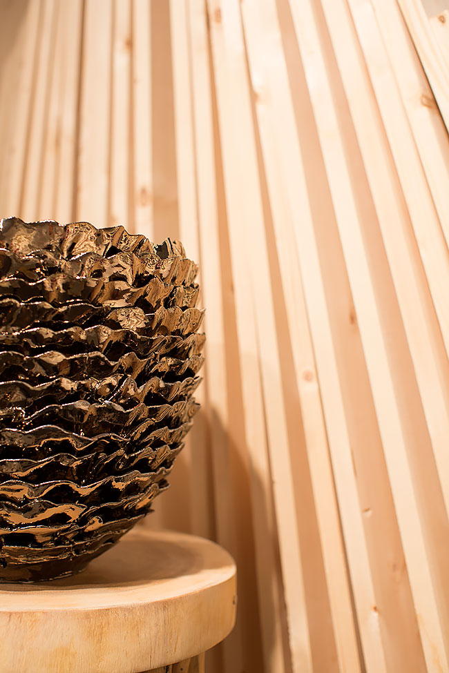 Mix metals, ceramics and natural elements for a modern and eclectic product display