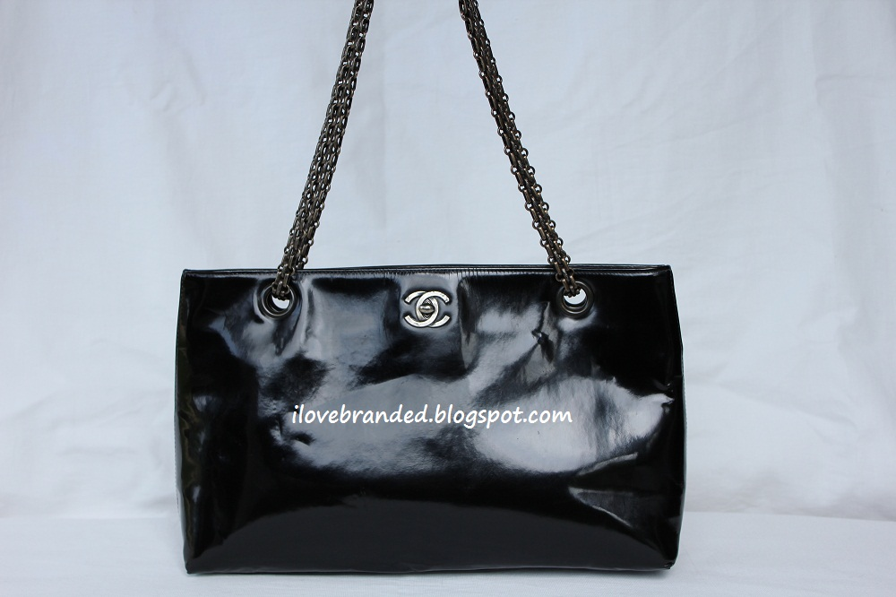 Chanel Hybrid Black Patent Tote Bag   This is a hybrid because it has a CC  lock (faux) and a reissue chain   Magnetic closure 90c9cc45b3ed6