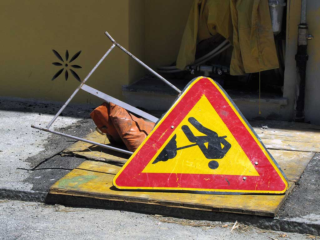 Knocked over sign of men at work, Livorno