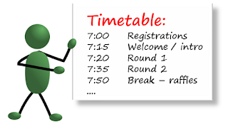 green stickman holding up the timetable for a quiz, starting at 7pm, with 15 minutes for each round