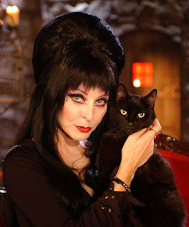 Elvira holding black cat