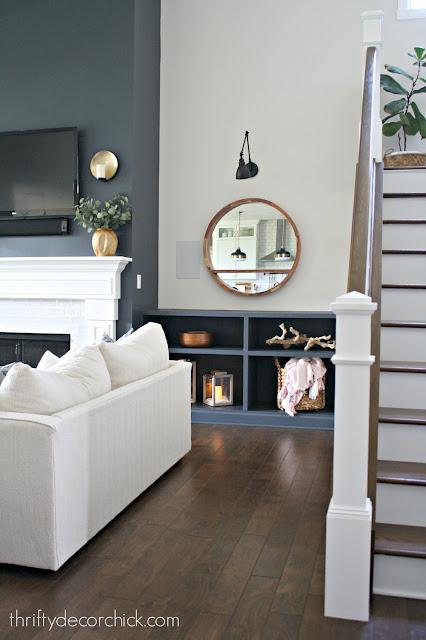 Dark tall fireplace with dark built ins