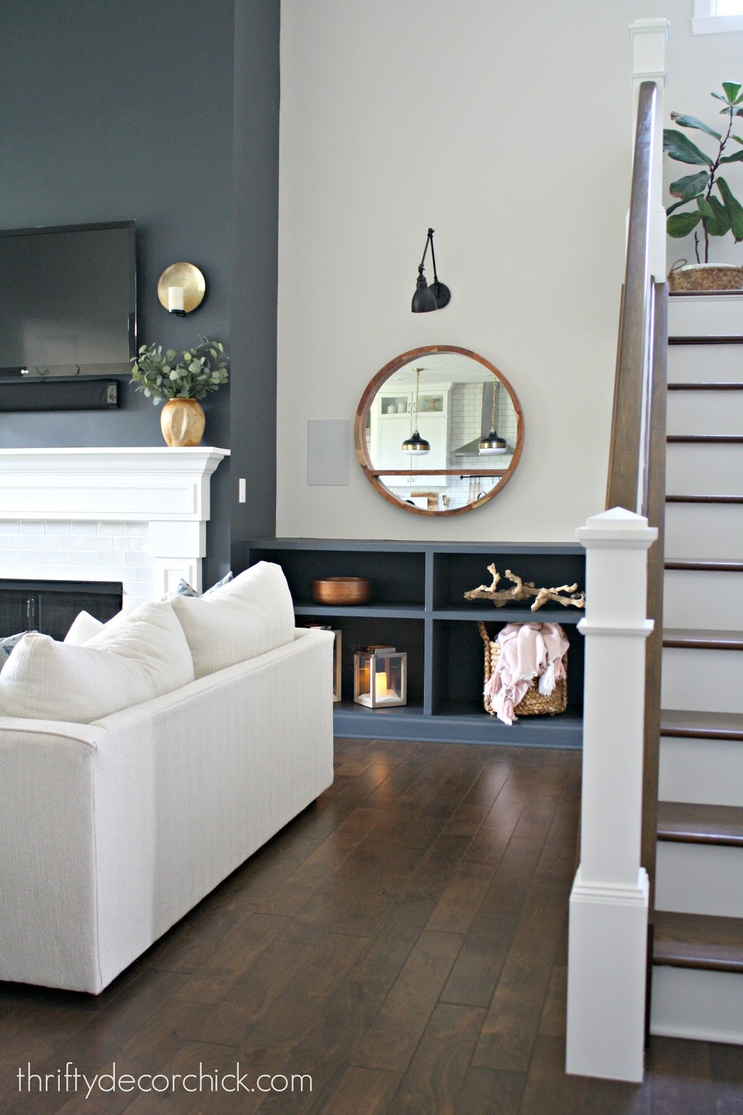 Dark tall fireplace with dark built ins