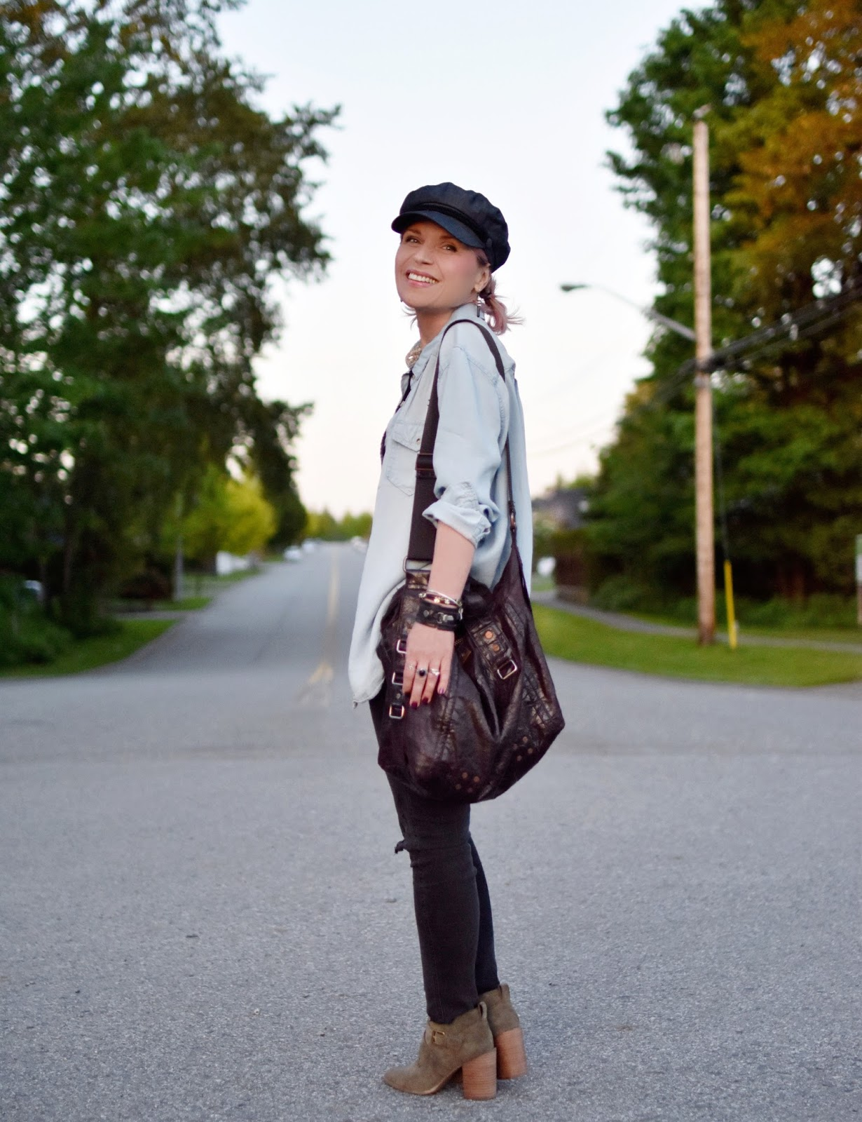 Monika Faulkner outfit inspiration - chambray shirt, black skinny jeans, olive ankle boots, baker boy cap