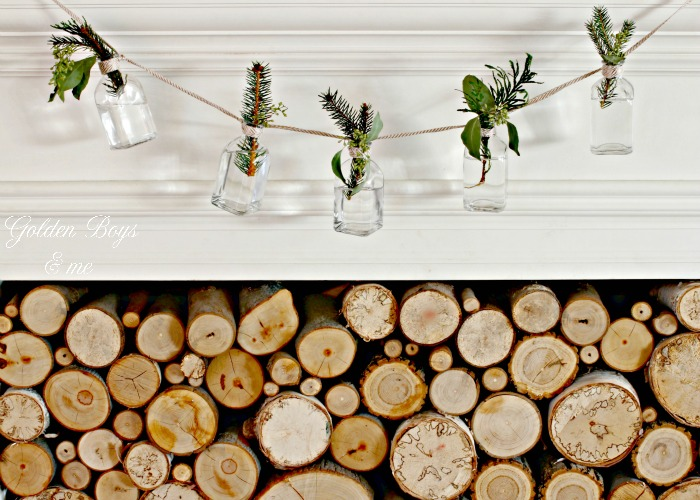 Small bottle garland with fresh greenery clippings as holiday decor - www.goldenboysandme.com