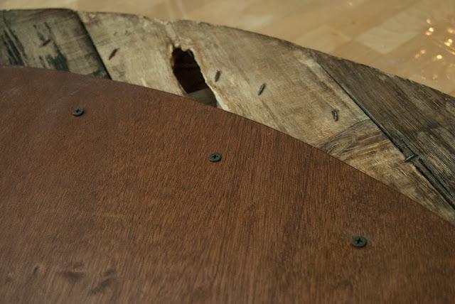 Black screws under table