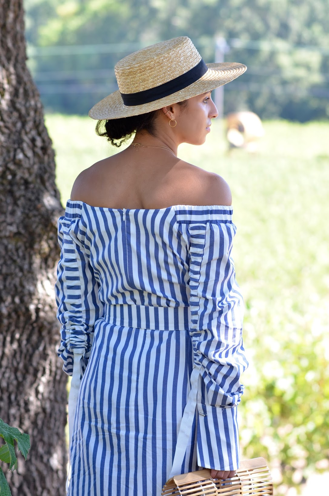 axr winery, calistoga wine tasting room, striped off the shoulder dress, wine tasting in calistoga, satin marigold slides, straw fedora, transitional dressing,