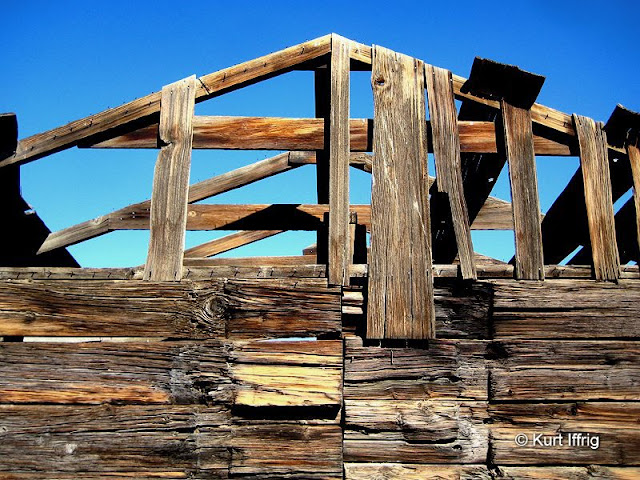 Walls of the two remaining wooden structures are about 8 inches thick, apparently built from railroad ties.