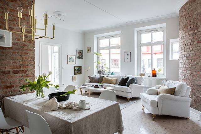 Accente pastelate și cărămidă expusă într-un apartament de 70 m²
